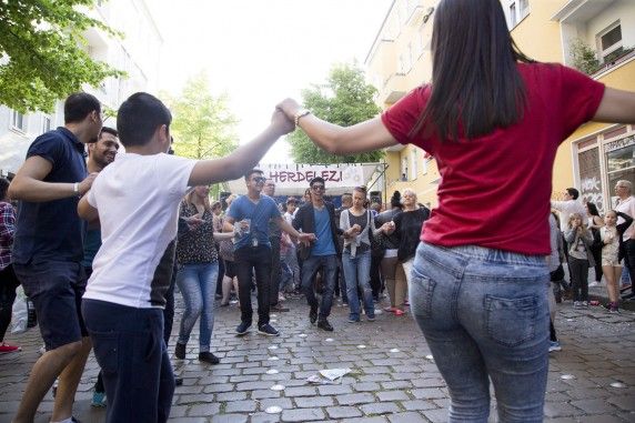 People dance during the 5th 'Herdelezi Roma Kulturfestival' in the Neukoelln district in Berlin, Germany on May 7, 2016.